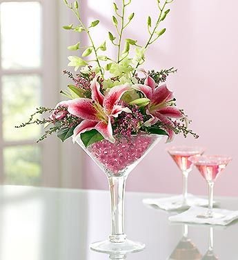 wine glass flower bouquet   orchids, lilies in oversized martini glass:)