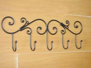 European-style wrought iron garden furniture behind the door, walls, coat racks, coat hooks