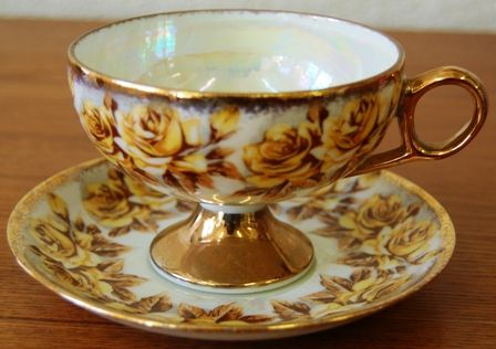 Gold and Yellow Rose Cup and Saucer.