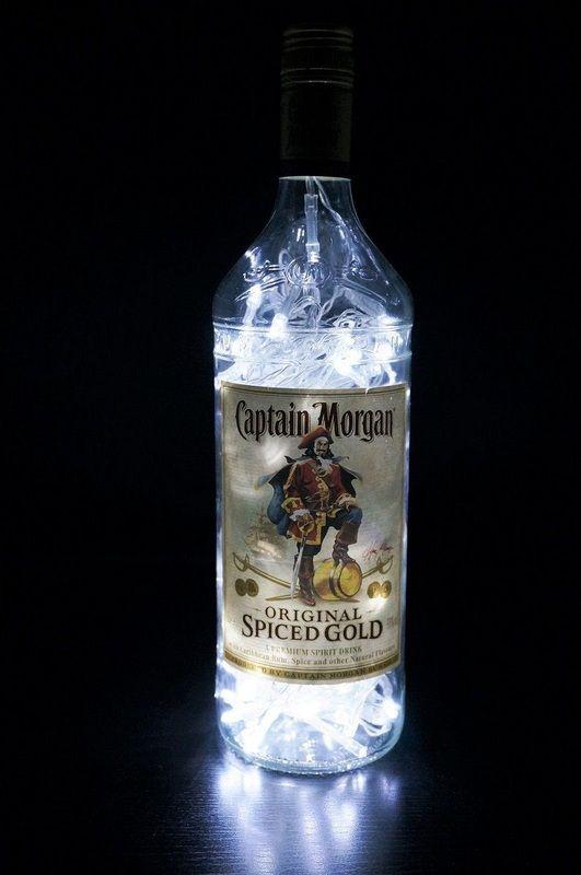 Pirate theme wedding decoration - upcycled rum bottle light. #pirate #wedding www.inviteinabottle.co.uk