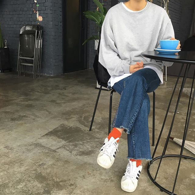 simple sweatshirt, high colorful socks, and addidas