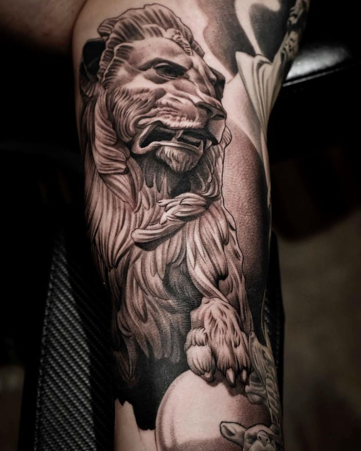 lion statue tattoo, black and grey tattoo, realism tattoo