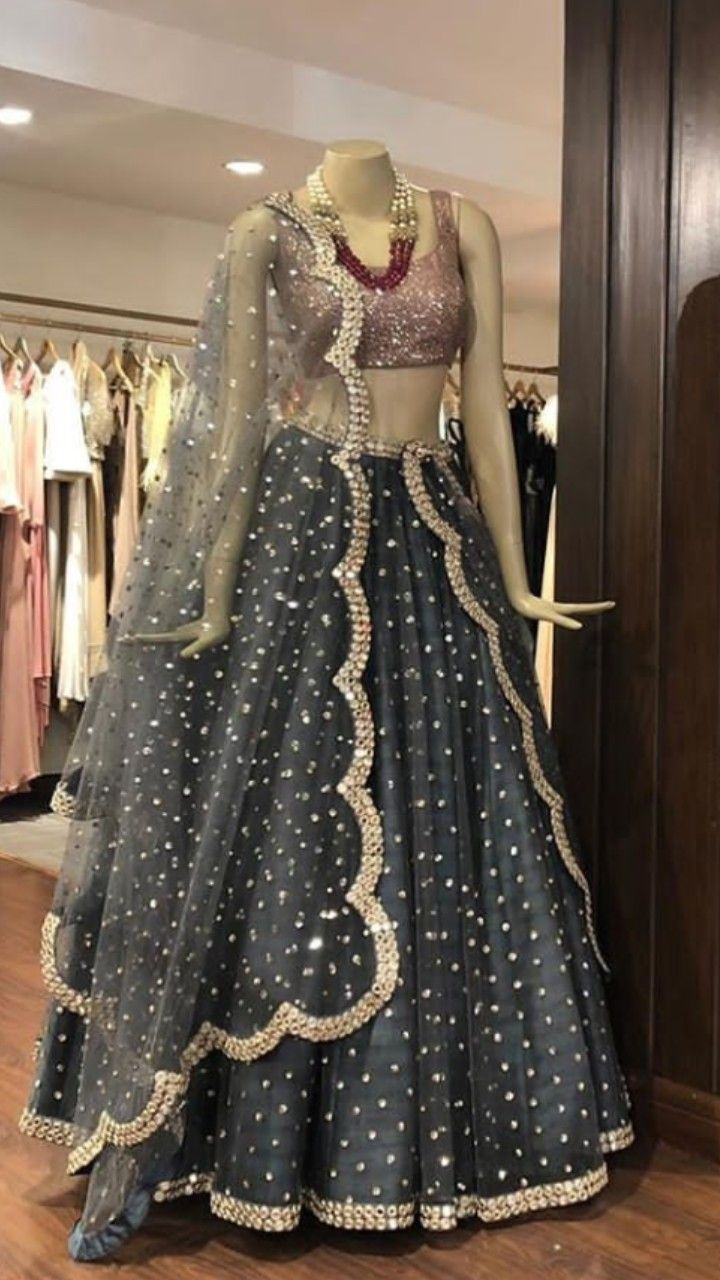 6fbdebbde3 Beautiful Silk Lehenga with golden work embellishments and hand Embroidered  blouse and beautiful net dupatta.