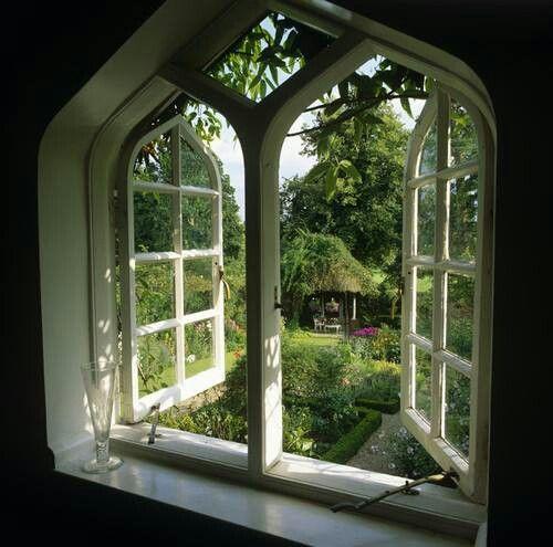 a gothic window onto a garden