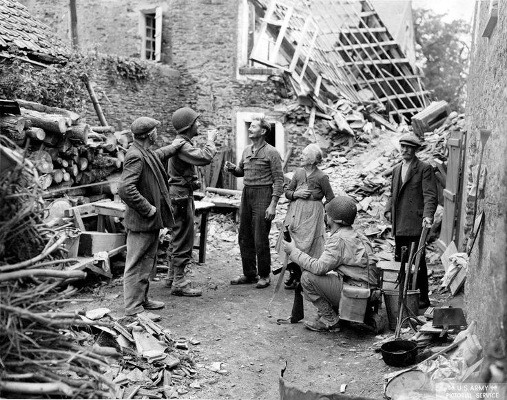 U.S. Soldiers Celebrate with French Civilians St. Lo Frace 1944 [1189x939]