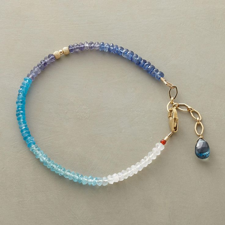 "ADRIATIC BRACELET -- Thoi Vo brightens sea blue gemstones with moonstone ""whitecaps."" Handmade in USA with kyanite, iolite, apatite and London blue topaz. 14kt goldfill accents. 7"" to 8""L."