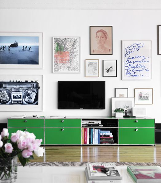 Cush and Nooks: Scandinavia Meets New York - gorgeous green console / sideboard + art wall around TV