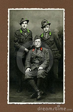 Taken in the north of Italy in 1943. Tree men in uniform during the fascist age.