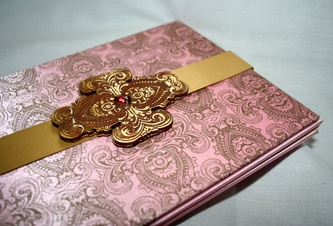 gold clasp, satin card, carved broach - perfect Indian wedding invitation