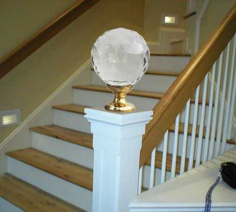 This Glass Finial Tops A White Newel Post To Start The Handrail