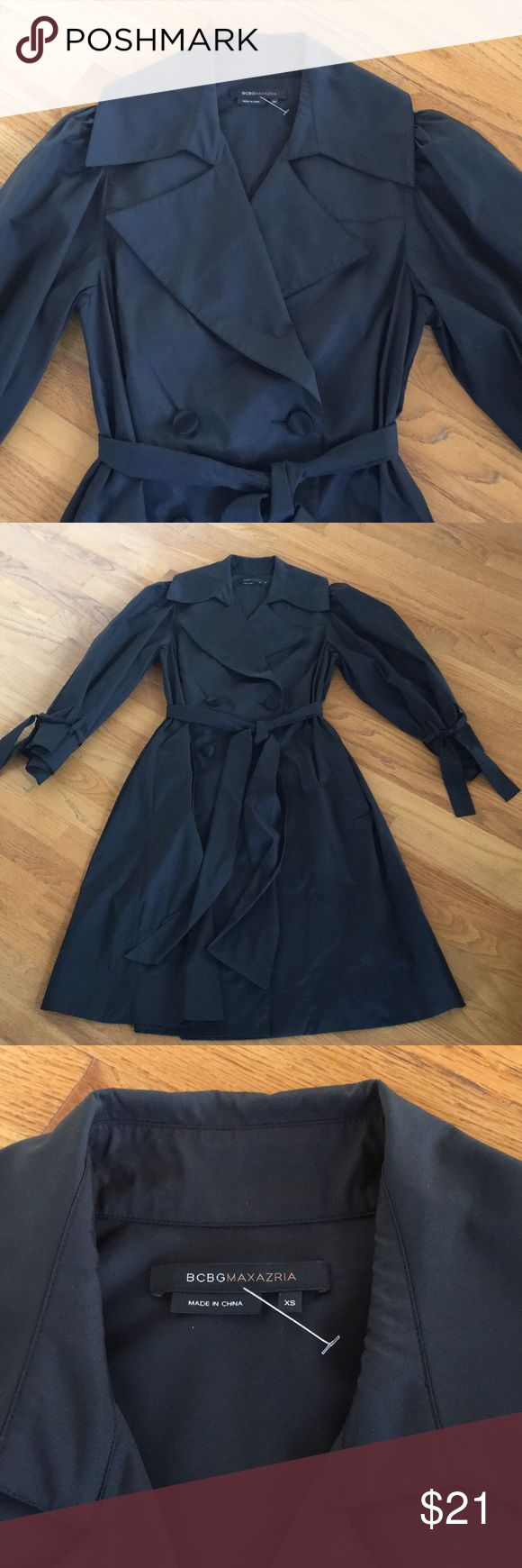 BCBGMaxazria Coat Authentic BCBG Maxazria coat. Size XS. Fits more like a size small. 100% polyester taffeta. Trent style with a beautiful flair. Sleeves have ties to adjust the fit. Has a beautiful waist sash that can be tied. Beautiful covered buttons. Brand new and never worn. Dryclean only. Comes from a smoke free and pet free home. Will ship ASAP. Please check out my other items. BCBGMaxAzria Jackets & Coats Trench Coats