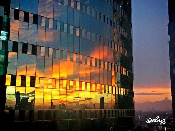 Sunset reflection on my new office building ✨ Menara Jamsostek 15 th floor Jakarta Indonesia  #sunset #reflection #building #newoffice
