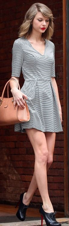 Who made  Taylor Swift's brown handbag, white stripe dress, and black lace up boots?