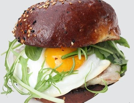 4505's decadently rich maple-bacon breakfast sausage sandwich oozes with a runny sunny-side-up egg over a maple-and-bacon-infused sausage patty. T