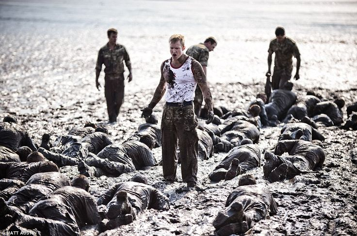 Crawling through the mire of the Exe estuary in Devon, these recruits are taking part in the notorious Mud Run - the most feared part of the Royal Marines' training course