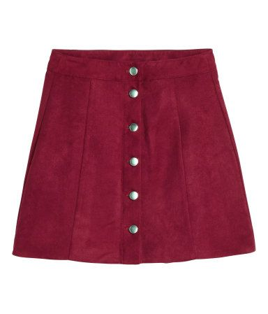 Short, A-line skirt with fasteners at front.