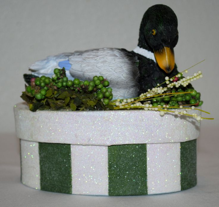 """""""The Duck"""" GIFT BOX/Cake Topper in a deep green and white stripe. A handsome duck sits on top amid greenery. So perfect for a GIFT CARD for Dad, or a male in your life, and then he can keep change or other small assorted items in this forever box. Sleek with minimal foliage and the handsome duck any male would love to receive a gift in this GIFT BOX!!.......$20 #decoratedgiftboxes #handmadegiftboxes #decoratedboxes #fathersgifts"""