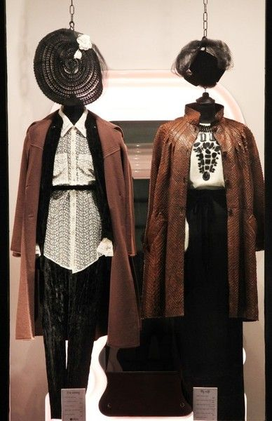 On the left wearing:1970s brocade suit, M.G. Severi lace shirt, 1970s wool coat, 1940s tulle and straw hat, 1950s silk pump.  Oufit on the right: 1980s Krizia jumper, 1980s Valentino Boutique skirt, 1980s Rose Bertin python coat, 2.4m long glass pearls necklace, 1950s milliner's hat with tulle, Fendi ankle boots.