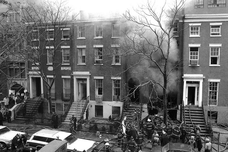 Firefighters extinguishing a nail bomb explosion of a Greenwich Village townhouse in 1970. By Marty Lederhandler/AP Images.