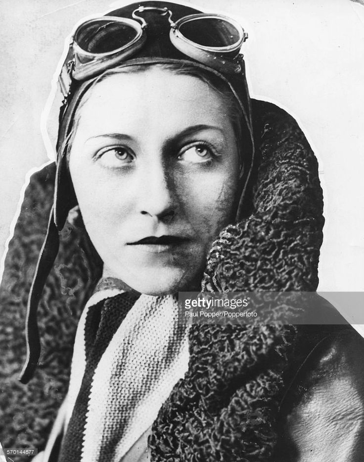 Portrait of English aviator Amy Johnson (1903-1941) wearing her flight jacket, cap and goggles, circa 1935.