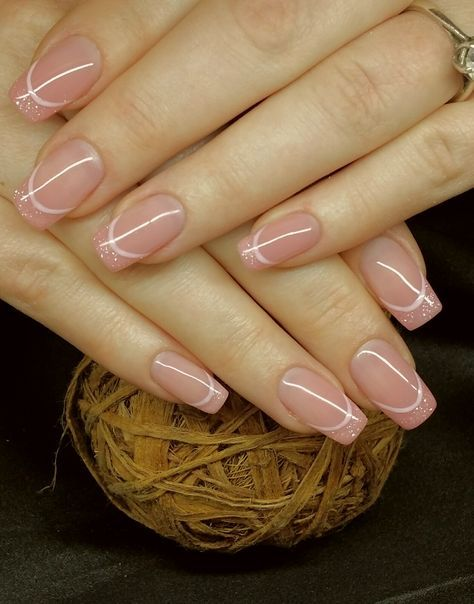 Pretty light pink nails with glitter