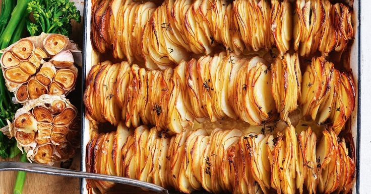 Compliment your main with this golden roasted garlic and thyme potato stack.