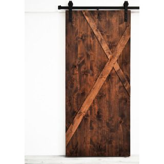 The Mod-X barn door features an asymmetrical x design overlaid on a solid wood base. This design fits well in modern contemporary, mid-century, or traditional settings. Place two doors together to cre