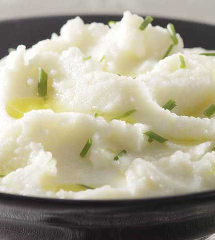 Creamy Mashed Cauliflower - Our savory cauliflower puree makes a perfect low-carb stand-in for mashed potatoes. It gets its fabulous flavor from garlic, a touch of margarine, and, best of all, it has about one-quarter of the calories of typical mashed potatoes. If you like, vary it by adding chopped fresh herbs.