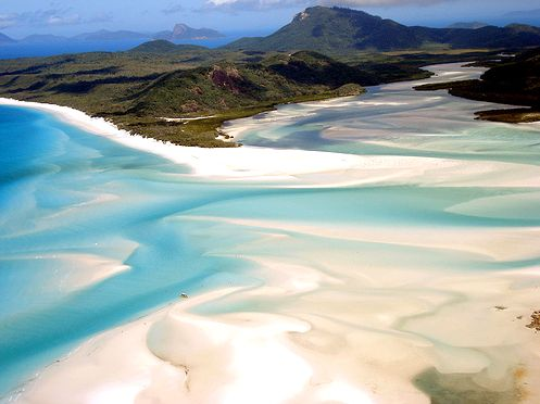 Whitehaven Beach, Australia  Located in Whitsunday Island, this beach has a sloshy appearance that looks as if a smoothie was dumped between emerald-green hills. This is due to the tides that shift the sand. Whitehaven Beach, Whitsunday Island, Australia - Bing Images