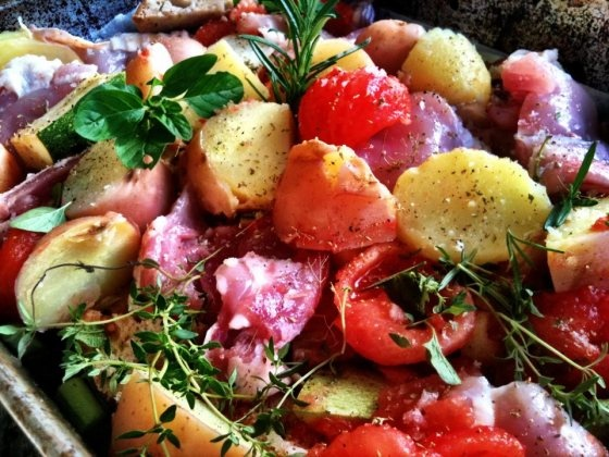 Italian chicken bake with potatoes, tomatoes, rustic bread and wine.