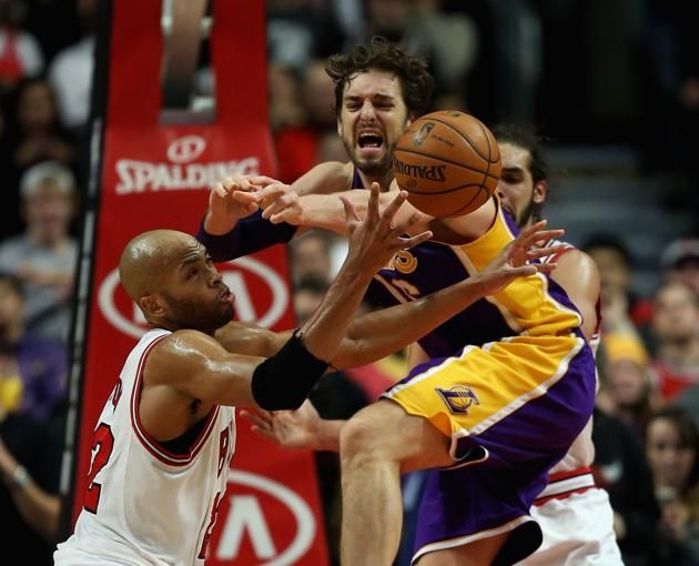 CHICAGO, IL - JANUARY 20: Taj Gibson #22 of the Chicago Bulls grabs the ball away from Pau Gasol #16 of the Los Angeles Lakers at the United Center on January 20, 2014 in Chicago, Illinois. The Bulls defeated the Lakers 102-100 in overtime. NOTE TO USER: User expressly acknowledges and agrees that, by downloading and or using this photograph, User is consenting to the terms and conditions of the Getty Images License Agreement. (Photo by Jonathan Daniel/Getty Images)
