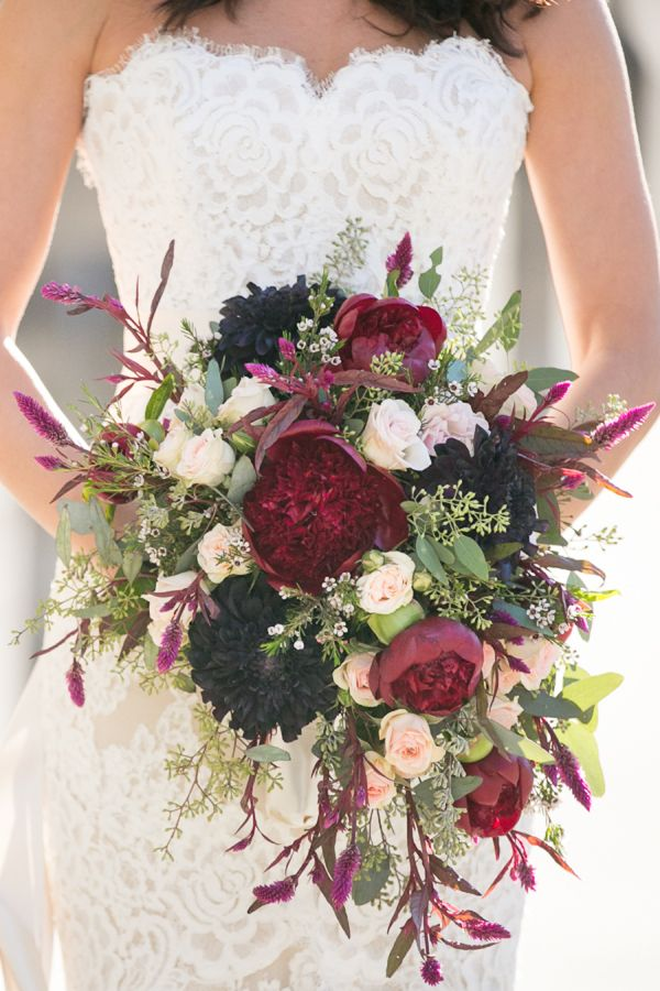 Deep burgundy and purple mixed wedding bouquet: http://www.stylemepretty.com/new-york-weddings/new-york-city/manhattan/2015/11/24/supergirl-actress-laura-benantis-elegant-new-york-city-wedding/ | Photography: Laura Marie Duncan - http://lauramarieduncanphoto-weddings.com/