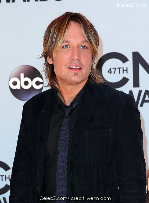 Keith Urban 47th Annual CMA Awards Red Carpet at the Bridgestone Arena in Nashville TN http://www.icelebz.com/events/47th_annual_cma_awards_red_carpet_at_the_bridgestone_arena_in_nashville_tn/photo6.html