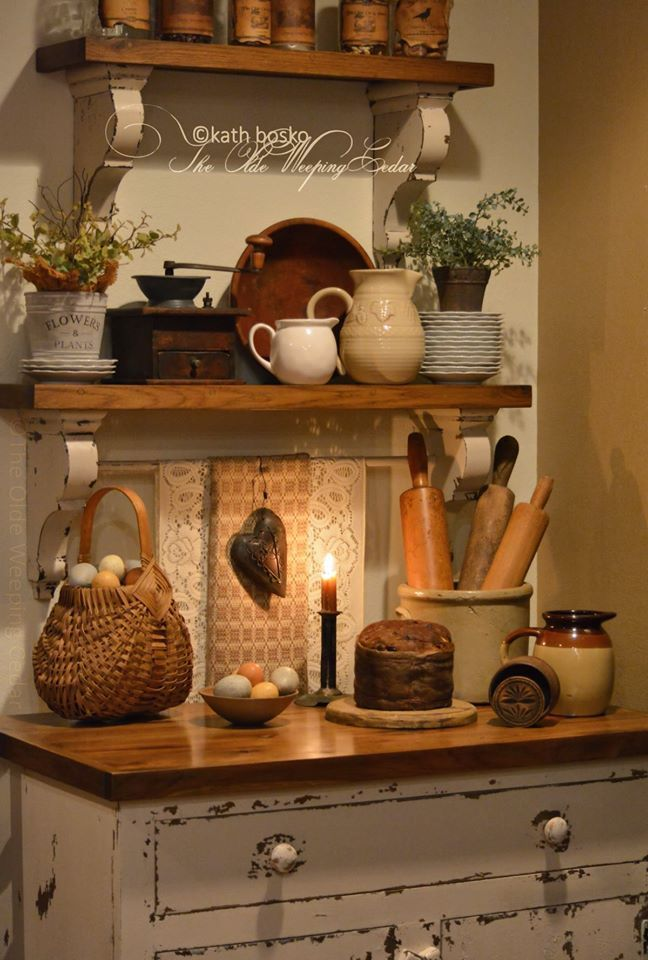 The Olde Weeping Cedar Rustic kitchen cupboard with shelves above it