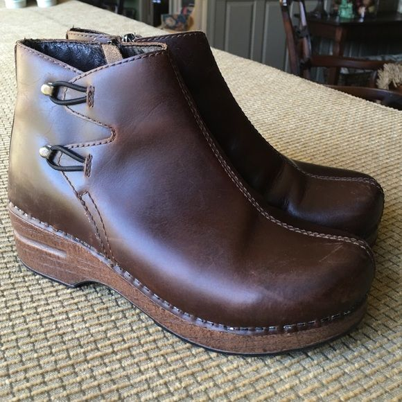 Dansko brown leather ankle boot clog EU 37 cute Great pair of brown leather side zip Dansko paddock style boots. Also have double elastic glue at ankle on the outside of the boot. One elastic loop has come loose but is an easy repair. Don't miss these vintage Dansko's. They don't make them like this anymore. Dansko Shoes Ankle Boots & Booties