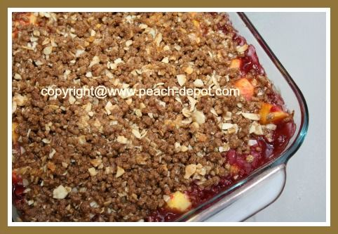 This Raspberry Peach Crisp Recipe with Pictures has a topping made of all-bran cereal and sliced nuts, a great idea for a dessert made with raspberries and peaches!