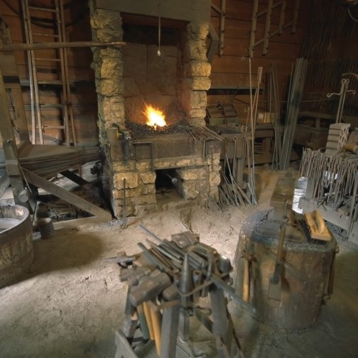 The John Deere Historic Site features a replica of Deere's blacksmith shop where he created the first self-scouring plow.