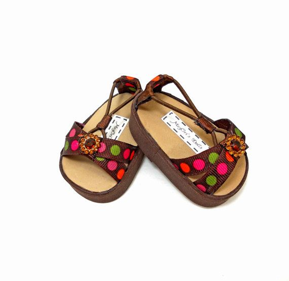 These sandals are made with elastic loops that form a cute ring around the doll's ankle. They are made of foam and narrow ribbons. Each sandals is decorated with a dainty ribbon bow and black jewel flower.  american girl dolls sandals shoes DAHLIAS brown by MegOrisDolls,