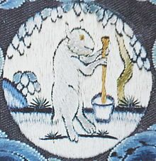 The Moon rabbit in folklore is a rabbit that lives on the moon, based on pareidolia that identifies the markings of the moon as a rabbit. In Aztec mythology and East Asian folklore, it is seen pounding in amortar and pestle. In Chinese folklore, it is constantly pounding the elixir of life for goddess Chang'e; but in Japanese and Korean versions it is just pounding the ingredients for rice cake.