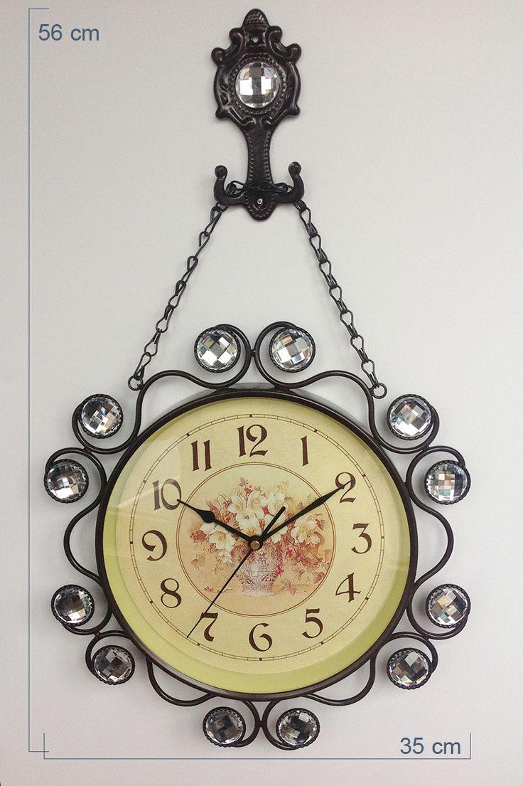 Ferforje Taşlı Dekoratif Duvar Saati Modeli 2014  Ürün Bilgisi ;  Uzunluk : 56 cm Genişlik : 35 cm Ürün maddesi : Metal Dekoratif ve şık tasarım Dilerseniz giriş kapısı için de anahtarlık içinde kullanabilirsiniz Taşlı hoş tasarım Ürün rengi : Kahverengi Ürün resimde görüldüğü gibidir