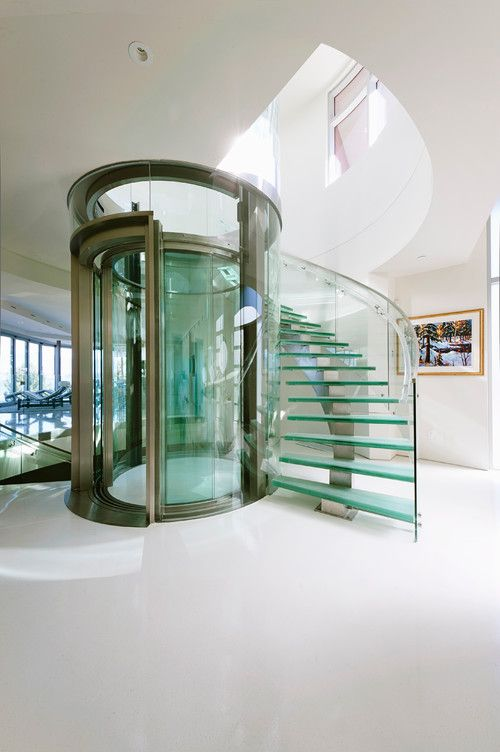 Glass elevator and staircase builder: Falcon Homes. Photo by Jason Brown - Revival Arts | Architectural Photography, Abbotsford, BC.