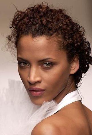 Noemie Lenoir. Slicked back silky curls.