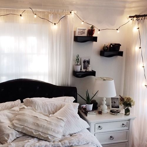 I love the floating shelves! Unique shape and dark color, all the way up the wall like they are, above the nightstand. Feels cozy to me.