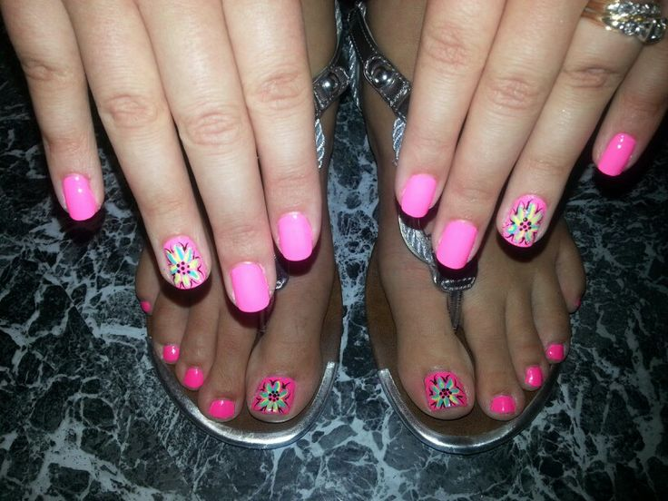 Pretty, pink nails with flower designs