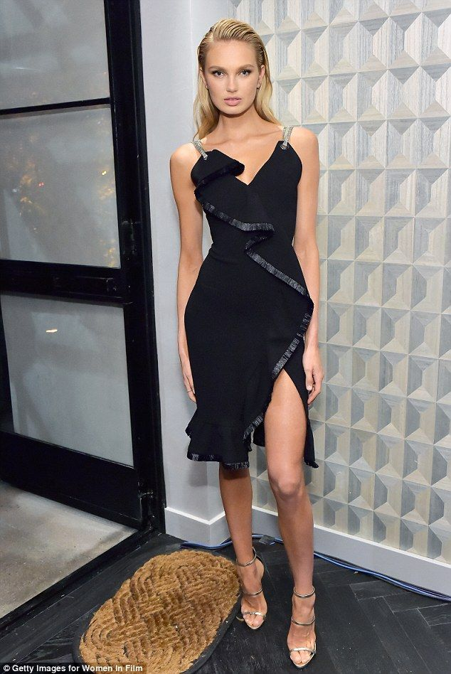 3280051a292 She s got legs  Victoria s Secret Angel Romee Strijd hit the red carpet at  pre-Oscar cocktail party in Beverly Hills on Friday