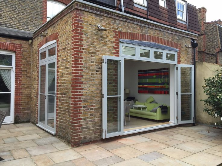 Not set on bi fold doors? You can achieve an open plan kitchen to garden with parliament hinges..