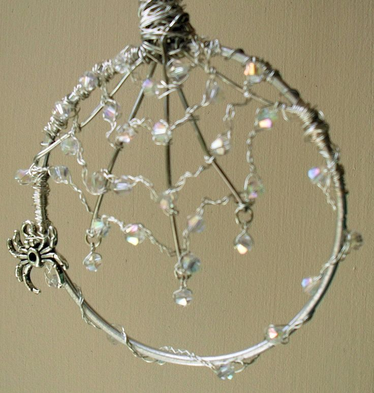 Beautiful wire work spider's web .  Free tutorial with pictures on how to make a sun catcher in under 150 minutes by beading, braiding, gardening, jewelrymaking, metalworking, weaving, and wireworking with wire, wire, and jump rings. Inspired by garden, craftroom, and spiders. How To posted by Becky . P . Difficulty: 4/5. Cost: 3/5. Steps: 1