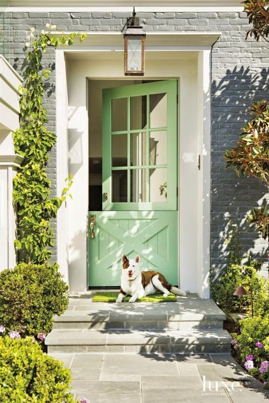 This colorful front door is just the cherry on top of a gorgeous home in Newport…