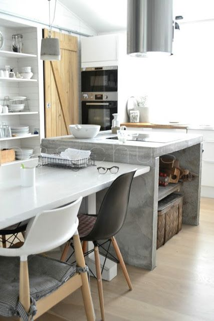 MODERN KITCHEN: eating dining table integrated with concrete kitchen waterfall island   basiclabelsweden: MYCKET PÅ GÅNG