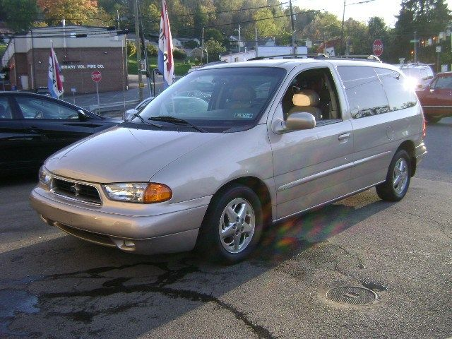 Hopping to buy this 1998 Ford Windstar Limted in the Light Prairie Tan ext and Tan leather Int with Bucket seating and rear air,Fog lights,16'' Chrome wheels,roof rack, built in cell phone. Was gonna buy it last year with 56k on it but it sold and now is forsale agian with 68k on it.